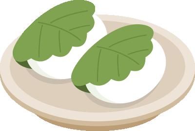 お皿にのせた柏餅のイラスト